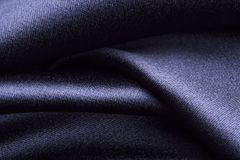 Forms of dark fabric texture. Wave forms of dark polyester fabric texture royalty free stock photo