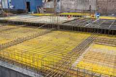 Forms for supporting walls and columns being readied. For concrete pouring Stock Image