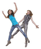Forms to joys. Two girls jump on white background Stock Images