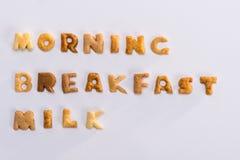 Formułuje ranek, śniadanie, mleko od abecadło kukurydzanych płatków odizolowywających na popielatym Obrazy Royalty Free