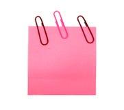 Formulário cor-de-rosa com um grampo Fotografia de Stock Royalty Free