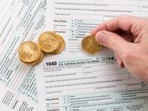 Formulário 1040 das moedas de ouro maciço 2014 Imagens de Stock Royalty Free