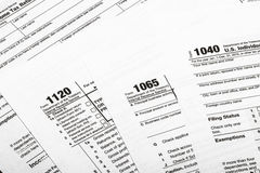 Formulário de imposto de 1040,1120,1065 E.U./conceito da tributação Imagem de Stock Royalty Free