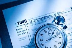 Formulário de imposto e cronômetro Foto de Stock Royalty Free