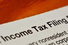 Formulário do arquivamento do imposto de renda Fotos de Stock Royalty Free