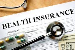 Formulário do seguro de saúde com estetoscópio Imagem de Stock Royalty Free