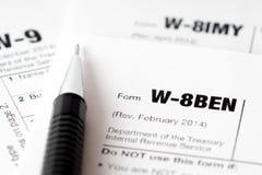 Formulários de imposto e lápis preto fotografia de stock royalty free