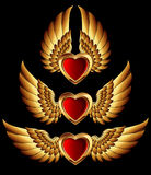 Formulários do coração com asas douradas Imagem de Stock