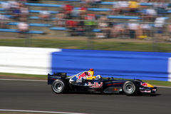 Formula 1 car at Silverstone. Nice Red Bull Formula 1 car in motion at Silverstone Grand Prix Royalty Free Stock Images