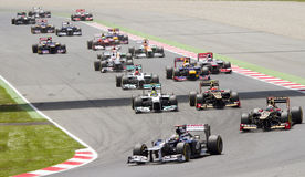 Formula 1 cars racing. BARCELONA - MAY 13: Some cars racing at the race of Formula One Spanish Grand Prix at Catalunya circuit, on May 13, 2012 in Barcelona stock image