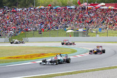 Formula 1 Grand Prix of Catalonia. BARCELONA - MAY 13: Some cars racing at the race of Formula One Spanish Grand Prix at Catalunya circuit, on May 13, 2012 in royalty free stock photography