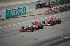 Formula 1 Sepang 2010 Button vs Alonso  Royalty Free Stock Photography