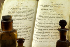 The formula. Old chemical book and small bottles Stock Photo