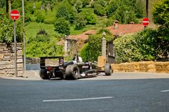 Formula 3 car at Bergamo Historic Grand Prix 2017. A black Formula 3 car driving down the hairpin at the end of Boccola street in Citta` Alta the medieval part Royalty Free Stock Photography
