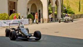 Formula 3 car at Bergamo Historic Grand Prix 2017. A black Formula 3 car driving down the hairpin at the end of Boccola street in Citta` Alta the medieval part Royalty Free Stock Images