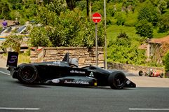Formula 3 car at Bergamo Historic Grand Prix 2017. A black Formula 3 car driving down the hairpin at the end of Boccola street in Citta` Alta the medieval part Stock Photography