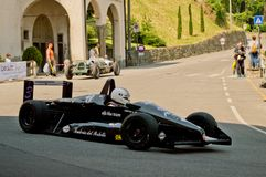 Formula 3 car at Bergamo Historic Grand Prix 2017. A Formula 3 car driving down the hairpin at the end of Boccola street in Citta` Alta the medieval part of Stock Photos