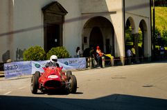 Formula 2 car at Bergamo Historic Grand Prix 2017. A Formula 2 car from the fifties turning into the hairpin in front of San Lorenzo alla Boccola church in Citta Royalty Free Stock Images