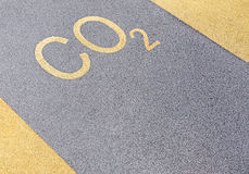 Formula on playground. Formula of carbon dioxide written on area with coating of rubber crumb. Copy space Royalty Free Stock Photo