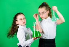 The formula is almost complete. school kid scientist studying science. children study chemistry lab. little smart girls. With testing flask. biology education stock photography