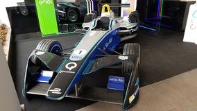 Formula E, Enel Race Car. Car is vehicle, automotive design and auto show. That marvel has race car, open wheel car and racing and that beauty contains formula Royalty Free Stock Image