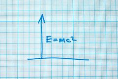 The formula is E = mc2 in the notebook per cell. Up arrow royalty free stock photos