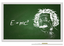 Formula e=mc2/. Albert Einstein portrait with chalk on chalkboard and his famous formula Stock Photography