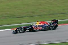 Formula On GP Round 2 in Sepang Malaysia. SEPANG, MALAYSIA - APRIL 10: Red Bull Formula One (F1) driver Sebastian Vettel has easily won at PETRONAS Malaysian Royalty Free Stock Photo