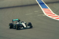 FORMULA 1 Grand Prix 2015. Nico Rosberg of Mercedes AMG Petronas F1 Team on the racetrack in Sochi on  October 2015. Front view of the turning point. Race car Royalty Free Stock Photography