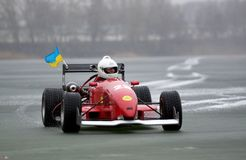 Formula on ice. Ukrainian champion racer Sergey Malik on a frozen lake set a speed record for Formula on ice (15-Feb-2014 Royalty Free Stock Photography