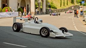 Formula Italia car at Bergamo Historic Grand Prix 2017. A Formula Italia car driving down the hairpin at the end of Boccola street in Citta` Alta the medieval Stock Photography