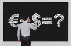 Formula money on blackboard. Young businessman drawing formula money on blackboard Stock Photo