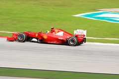 Formula one 2012. SEPANG, MALAYSIA - MARCH 23 : Ferrari Team driver Felipe Massa action on track during Petronas Malaysian Grand Prix second practice session at Stock Image