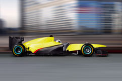 Formula one car driving Royalty Free Stock Photo