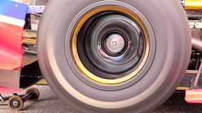 Formula one car wheel spinning while driver tests engine stock video