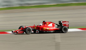 Formula one Gulf Air Bahrain Grand Prix 2015. Sebastian Vettel of Ferrari racing during practice session on Friday, April 17, 2015, Formula 1 Gulf Air Bahrain Royalty Free Stock Photography