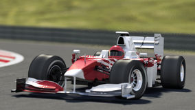 Formula one race car. On track with blurred background - own car design - high quality 3d rendering, modelled in maya, rendered with renderman Stock Photo