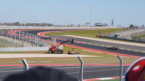 Formula One race car is hoisted in the Circuit of the Americas, 2012, Austin, Texas. A driver spun out in the COA during the inaugural race at Austin, Texas on Royalty Free Stock Image