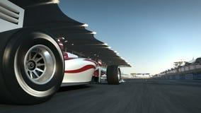 Formula One race car speeding along home stretch and past camera