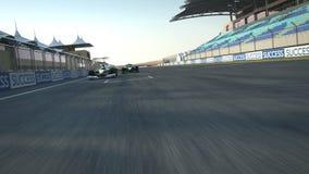 Formula one race cars crossing finishing line