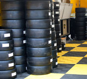 Formula One 1 race tires and wheels. In boxes Royalty Free Stock Image
