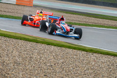 Formula A1 Race. ASSEN, NETHERLANDS - OCTOBER 19, 2014: Team Netherlands in pursuit of Team Great Britain during the final race of the Formula A1 GP Acceleration stock images