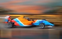Formula 4.0 race car racing at high speed. With motion blur royalty free stock image