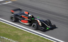 Formula 2 race car on a speed track with motion blur Stock Images