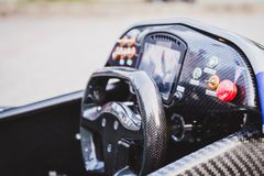 Formula racing car interior. With steering wheel Royalty Free Stock Photography