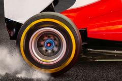 Formula 1 Rear wheel spinning and drifting after launch royalty free stock photography