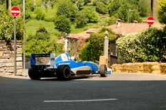 Formula Renault car at Bergamo Historic Grand Prix 2017. A Formula Renault car driving down the hairpin at the end of Boccola street in Citta` Alta the medieval Royalty Free Stock Image