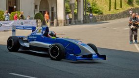 Formula Renault car at Bergamo Historic Grand Prix 2017. A Formula Renault car driving down the hairpin at the end of Boccola street in Citta` Alta the medieval Stock Images