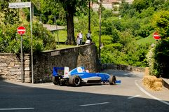 Formula Renault car at Bergamo Historic Grand Prix 2017. A Formula Renault car driving down the hairpin at the end of Boccola street in Citta` Alta the medieval Royalty Free Stock Photos