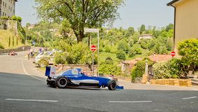 Formula Renault car at Bergamo Historic Grand Prix 2017. A Formula Renault car taking the hairpin at the end of Boccola street in Citta` Alta the medieval part Royalty Free Stock Image